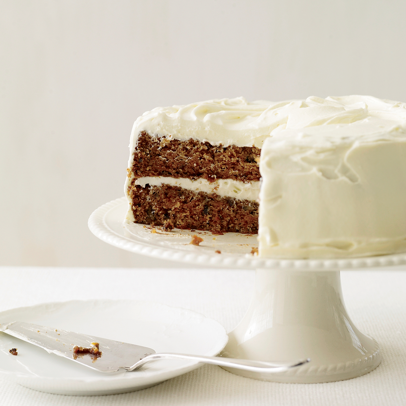 Read more on Classic carrot cake with fluffy cream cheese frosting .