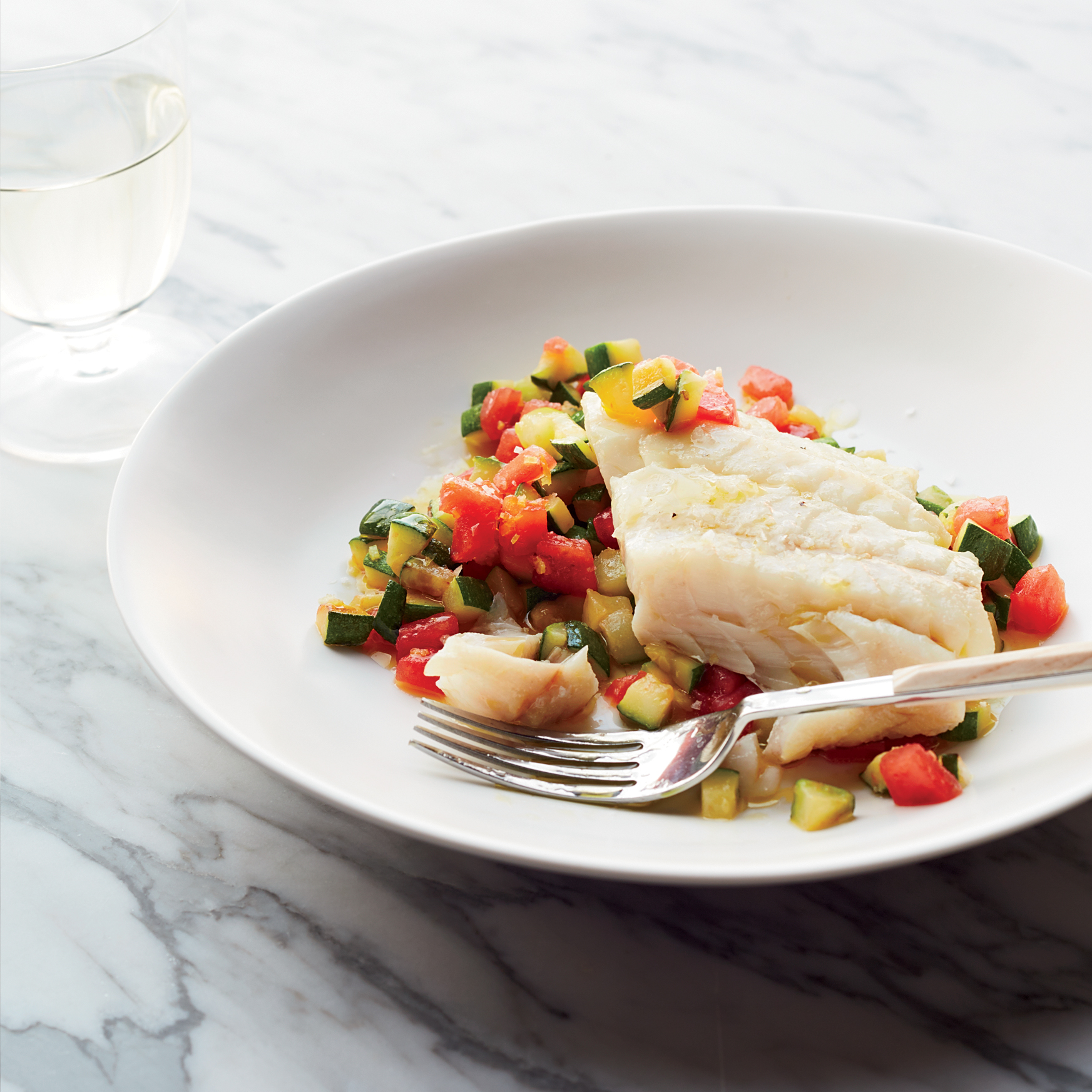 Olive Oil-Poached Hake on Sautéed Zucchini with Tomatoes Recipe ...