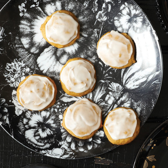 These soft, lightly spiced cake-like cookies are studded with minced candied ginger and topped with a buttery sugar glaze. / © David Malosh