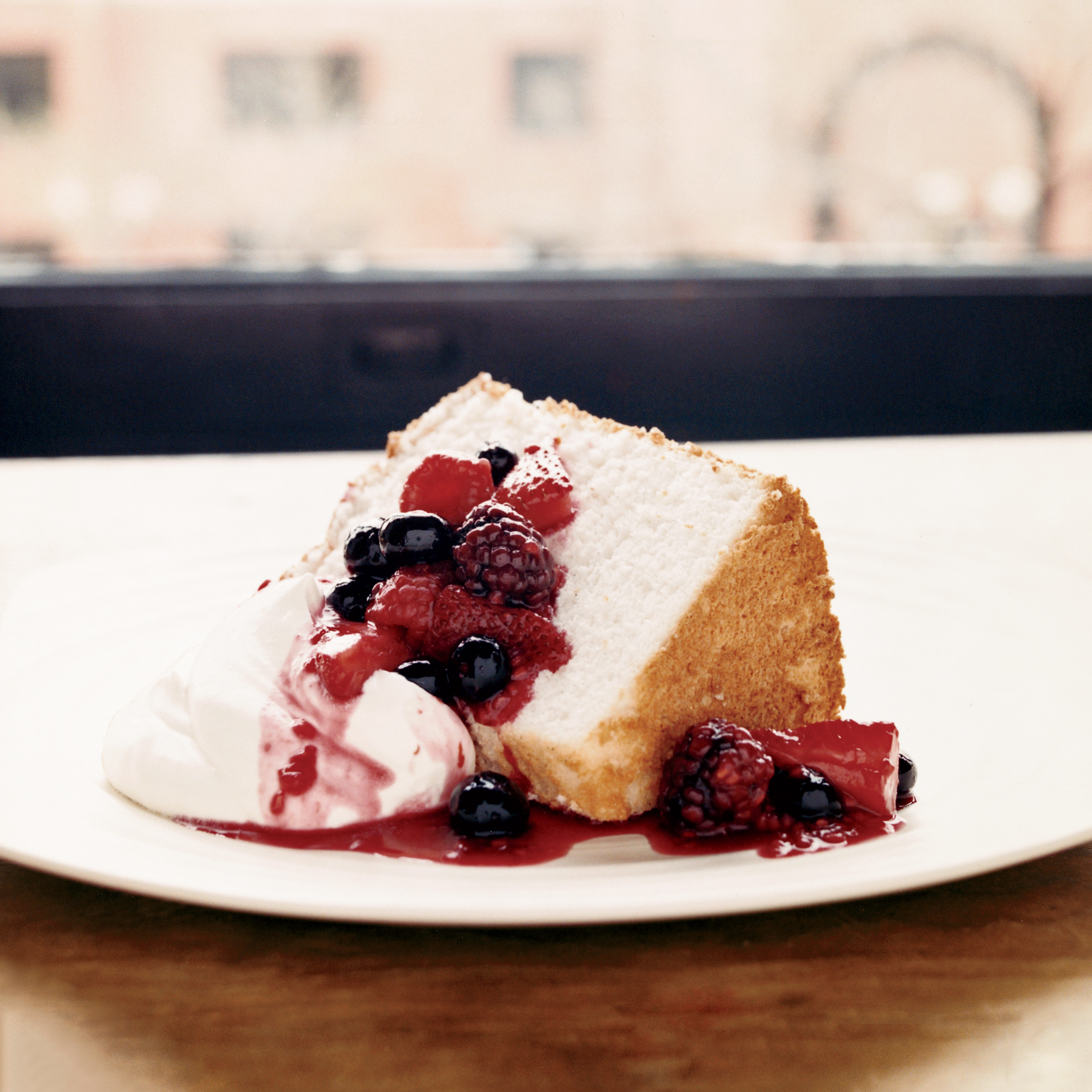 Angel Food Cake With Fruit Compote And Whipped Cream