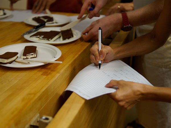 Tasting ice cream sandwiches in the Food & Wine test kitchen. Photo <a href=