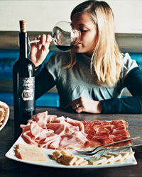 "Vinoteka Movia offers top local wines and snacks like prosciutto ""from happy pigs!"" Kristancic says."