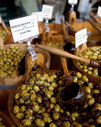 An olive stall at Borough Market,  a wholesale and retail food market in Southwark, South East London.