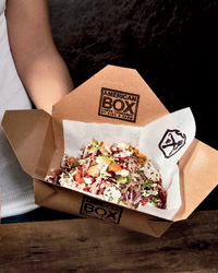 """American Box, an outpost of San Francisco's Fish & Farm, sells everything (like """"chop salad,"""" above) in logo boxes."""
