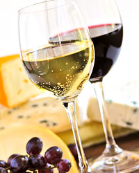 Wine with cheese and grapes.