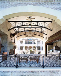 A grand Houston pavilion with two kinds of grills plus a bar area, complete with ice maker.