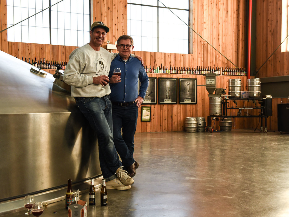 Sam Calagione and Rudi Ghequire at Dogfish Head Brewery