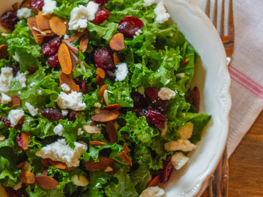 Kale salad with cranberries almonds and goat cheese for Salad for thanksgiving best recipes