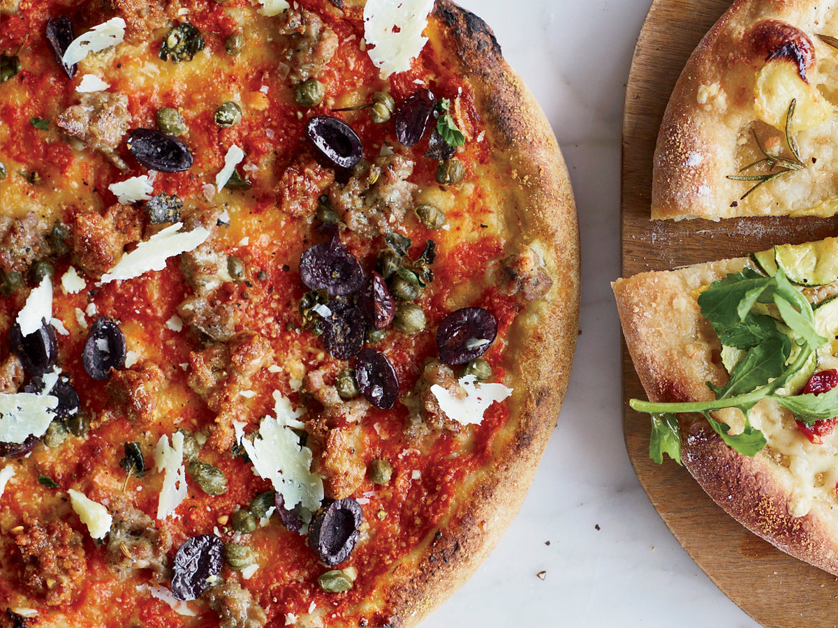 sausage and olive pizza with capers and pecorino sardo recipe thomas mcnaughton food wine. Black Bedroom Furniture Sets. Home Design Ideas