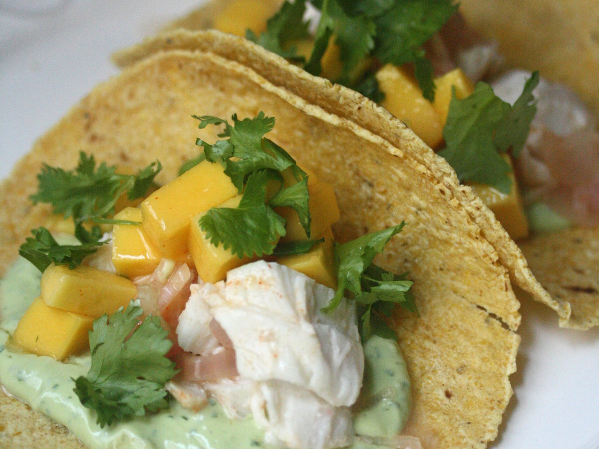 Roasted fish tacos with avocado crema and mango recipe for Side dishes for fish tacos