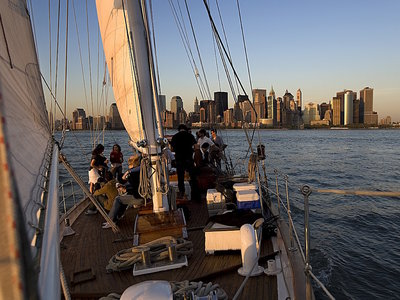 USA, new york, manhattan, sailing experience with bar aboard the shearwater, a wonderful yacht to rent for a romantic tour at the sunset over the manhattan tip