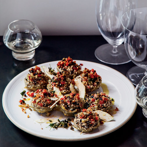 <p>Braised Artichoke Hearts Stuffed with Olives and Herbs</p>