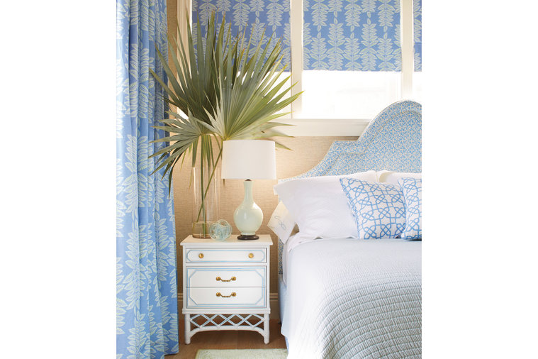 """Each of the three """"adult"""" bedrooms includes a pattern reflective of the foliage and animal life outdoors. For instance, in the master bedroom, Howard chose a tropical leaf pattern for the windows, complemented it with a smaller scale medallion..."""