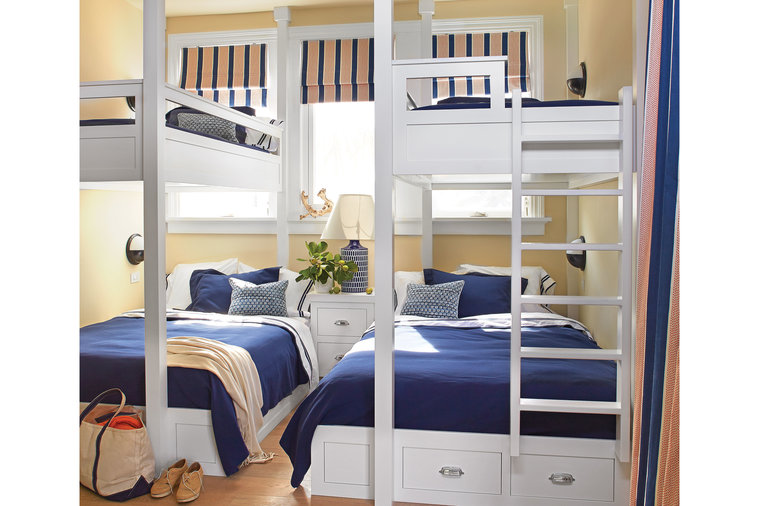 """Howard designed the built-in bunks in the boys' room as singles above, doubles below, and kept the pattern mix simple. """"In rooms that will eventually have to work as well for teenagers as they did for young children, don't overdo it,"""" he says. ..."""