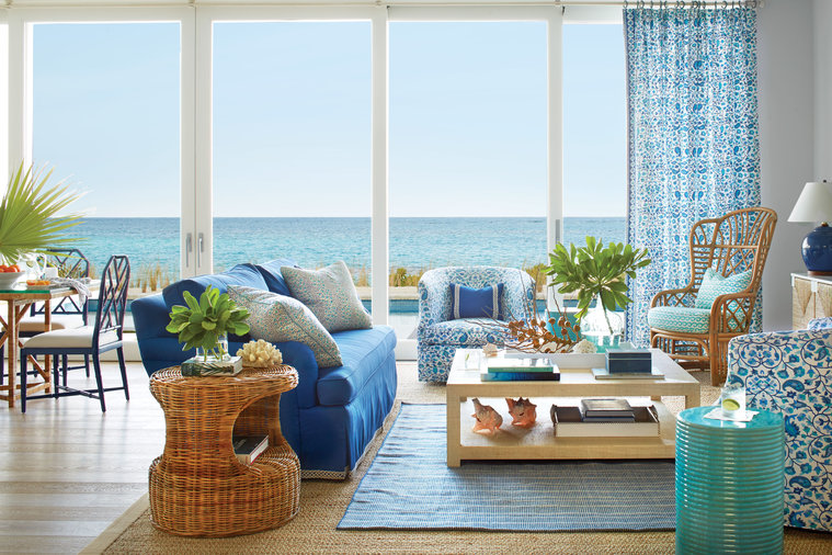 """Blue and green are everywhere you look outside, so I tried to keep at least one of those colors—sometimes both—in each of the rooms,"" says Howard. The sofa in the living room is upholstered in outdoor fabric—""You could pull this bad boy right..."