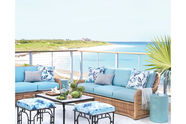 """""""There was no thought to using any other color on the terrace,"""" says designer Andrew Howard of the bright turquoise fabrics on the deck, which offers an elevated view of the jewel-toned ocean. Vintage, Chippendale-inspired ironwork mixes with new..."""