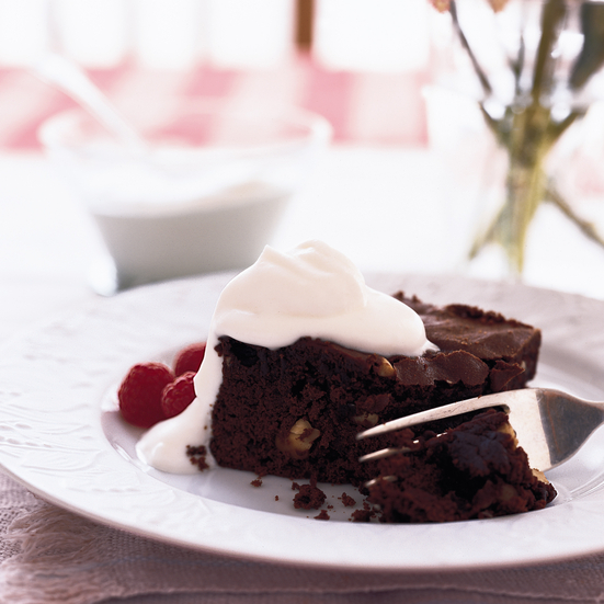 Chocolate Cake with Cashews, Berries and Whipped Cream