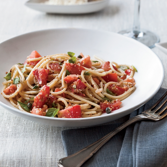 spaghettini with tomatoes anchovies and almonds