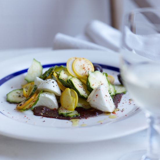 Mozzarella with Summer Squash and Olive Puree. Photo © Con Poulos