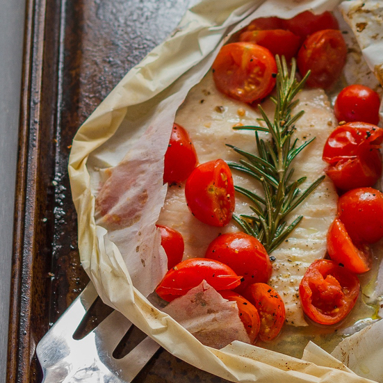 Tilapia in Parchment with Tomatoes, Rosemary and Garlic