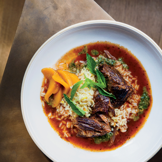 Red Wine-Braised Lamb with Saffron Rice, Mint Pistou and Pickled Peaches