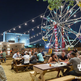 Food & Wine: This BBQ Restaurant Has a 50-Foot Ferris Wheel Out Back