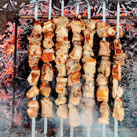 Food & Wine: Mtsvadi (Grilled Pork Skewers with Pomegranate and Onions)