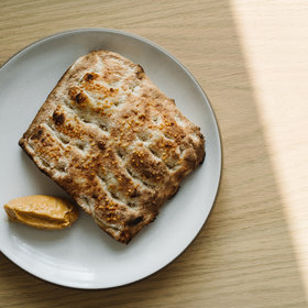 Food & Wine: Pay for the Bread Basket. Flour and Skills Cost Money