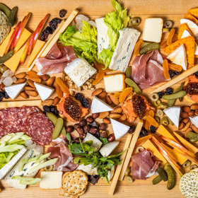 Food & Wine: How to Make a Fancy Cheese Board with Stuff from the Grocery Store