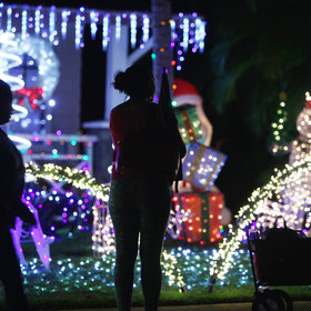 Food & Wine: Families Who Spend Thousands of Dollars a Year on Christmas Light Displays Explain Their Obsession