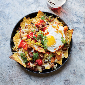 Food & Wine: Cheesy Nachos with Fried Eggs and Giardiniera