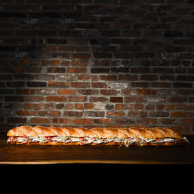 Food & Wine: Super Bowl Exposé: How Do They Make Those Giant Party Subs?