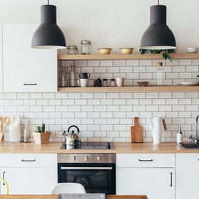 Food & Wine: This Unexpected High-Contrast Trend Is Taking Over Kitchen Cabinets