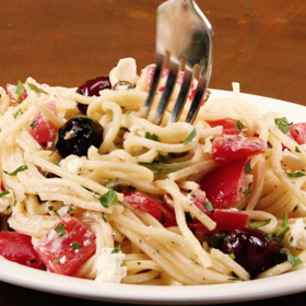 Food & Wine: Spaghetti with Tomatoes Black Olives Garlic and Feta Cheese