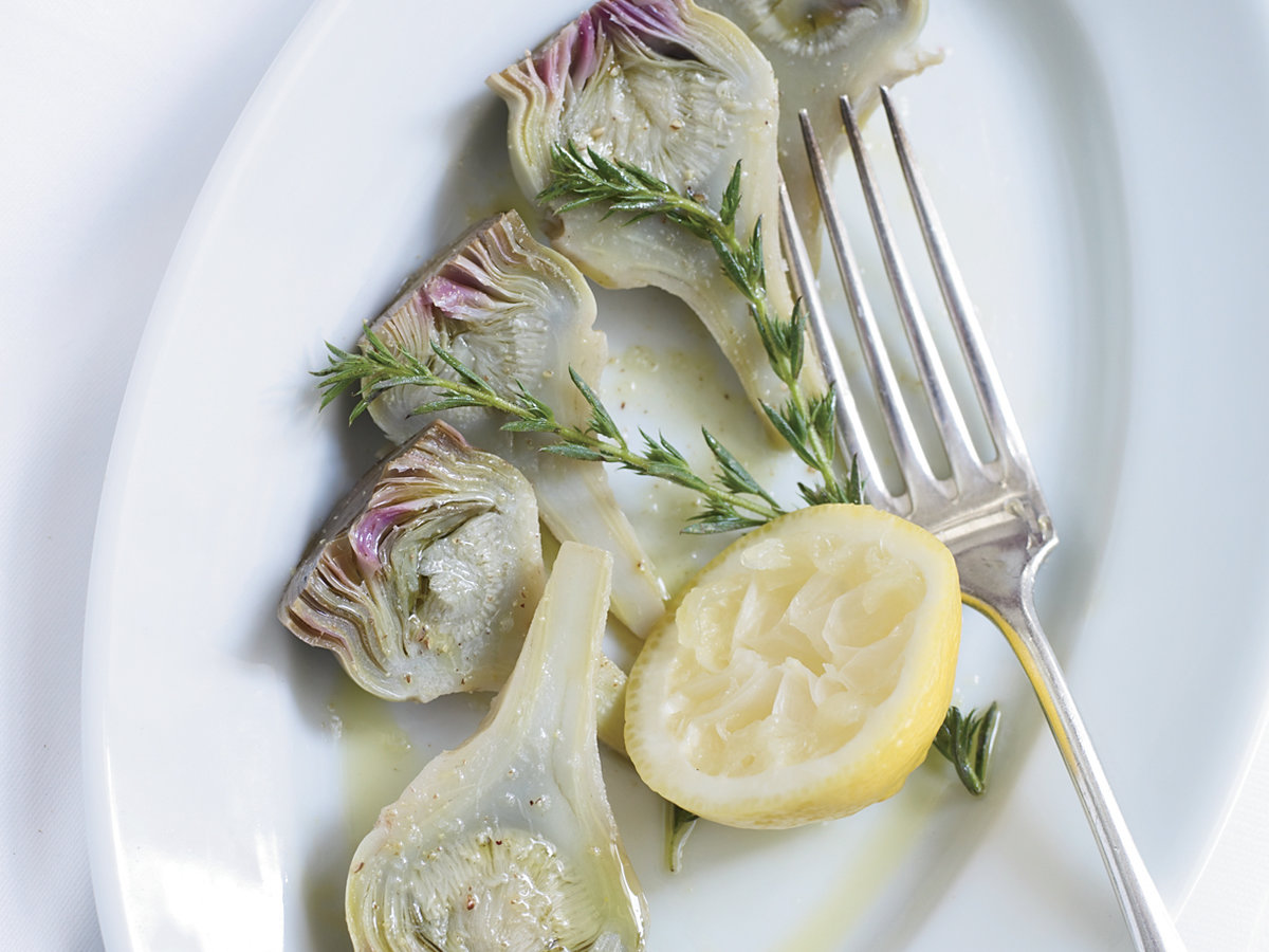 <p>Herb-and-Lemon-Poached Baby Artichokes</p>
