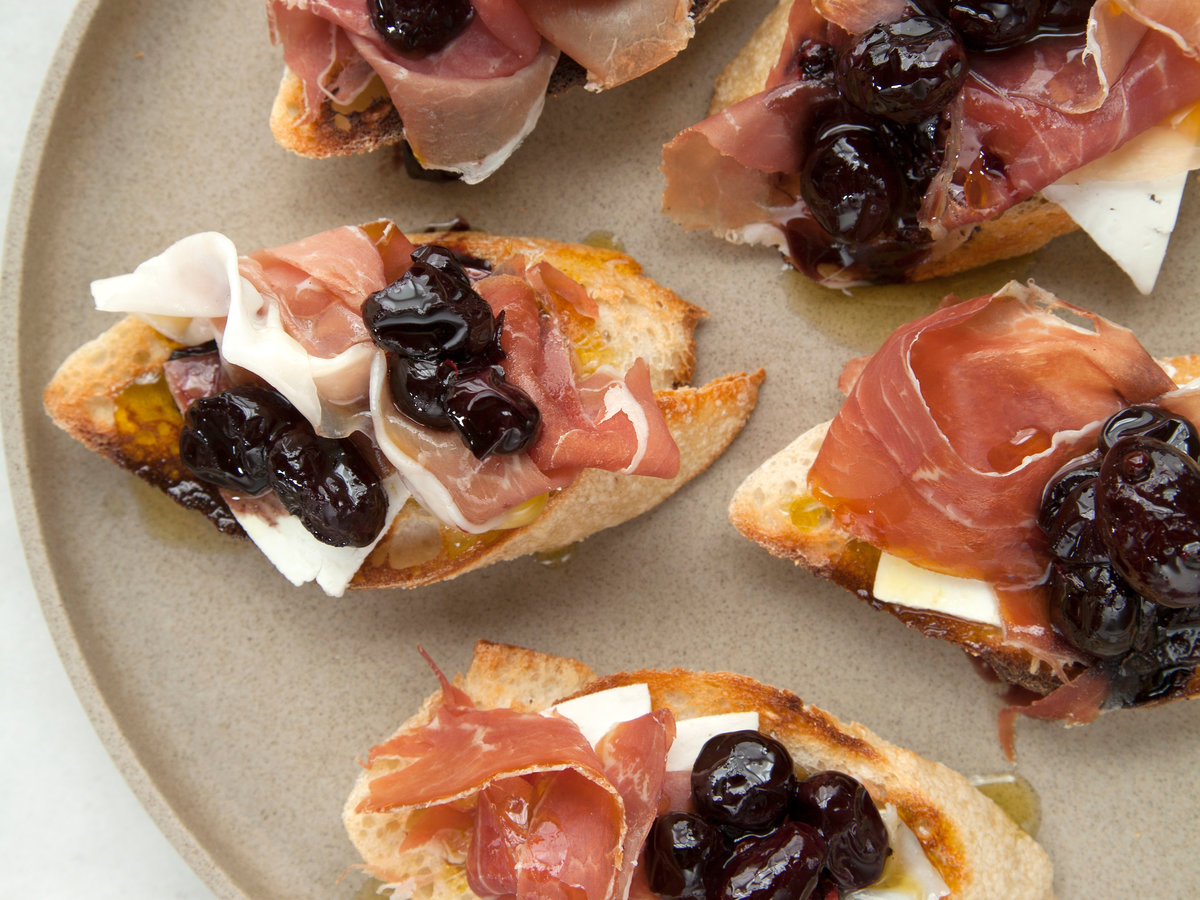 original-201401-r-crostini-with-stewed-black-grapes-prosciutto-and-ricotta-salata.jpg
