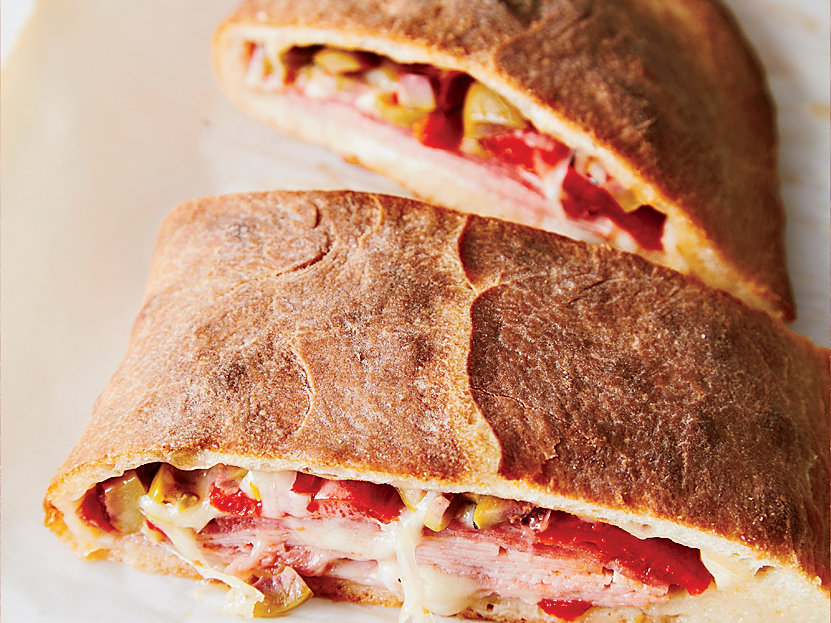 <p>March 8: Muffuletta Calzone</p>