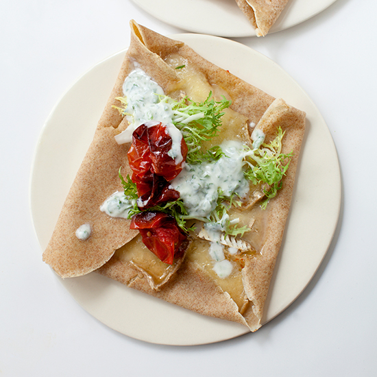 Food & Wine: Brie Crêpe Melts with Roasted Tomatoes and Herb-Buttermilk Sauce