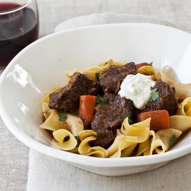 Food & Wine: A bowl of slow cooker beef goulash over warm buttery noodles