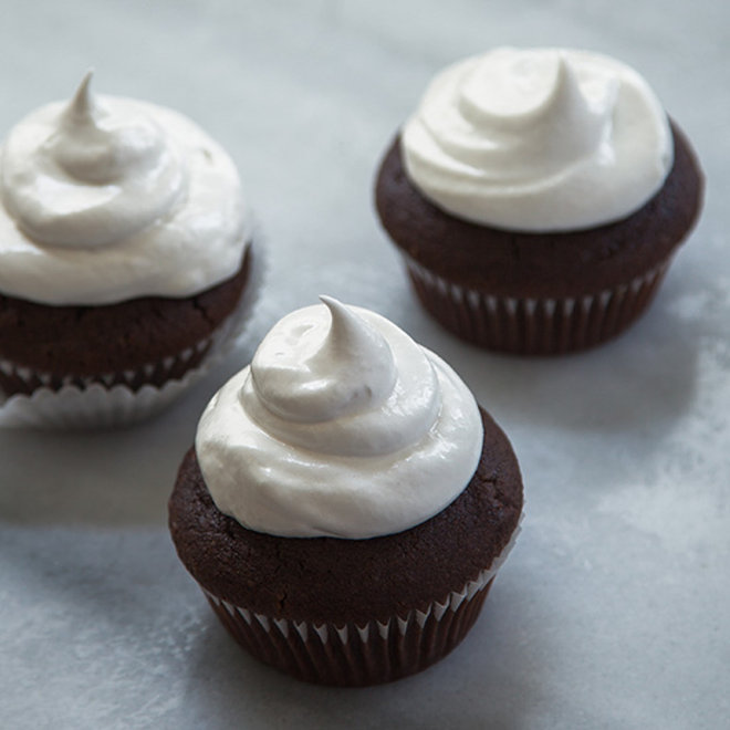 Hot Chocolate Cupcakes with Meringue Frosting. © Sarah Bolla