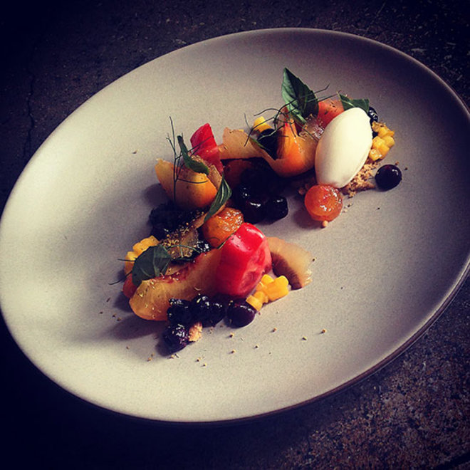 Food & Wine: Fresh and candied tomatoes with peaches, plums, and bitter almond sorbet.