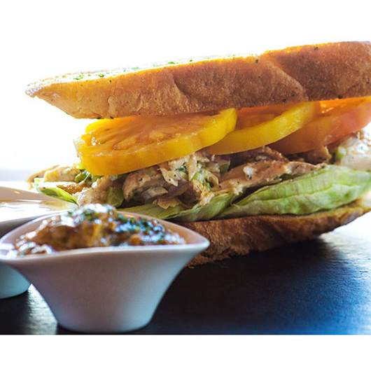 Food & Wine: The chicken sandwich at Bin 555 made with schmaltz.
