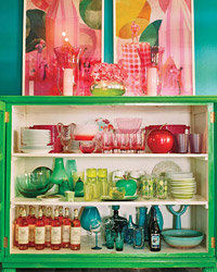 Food & Wine: A kelly-green china cabinet holds color-coordinated tableware.