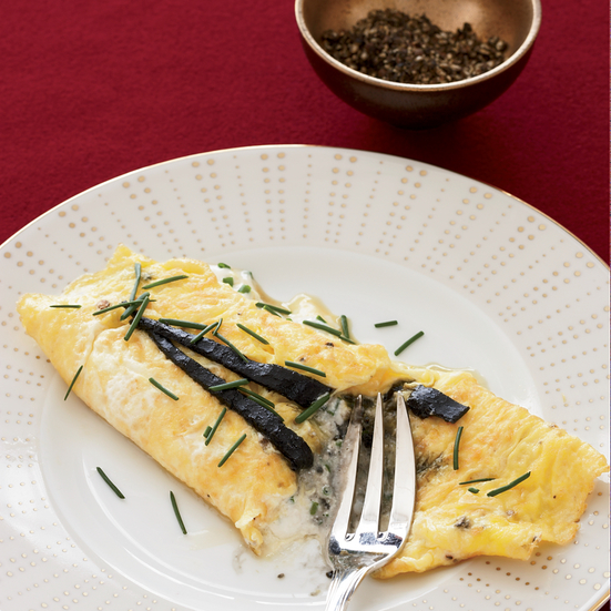 Omelet with pressed caviar and sour cream.