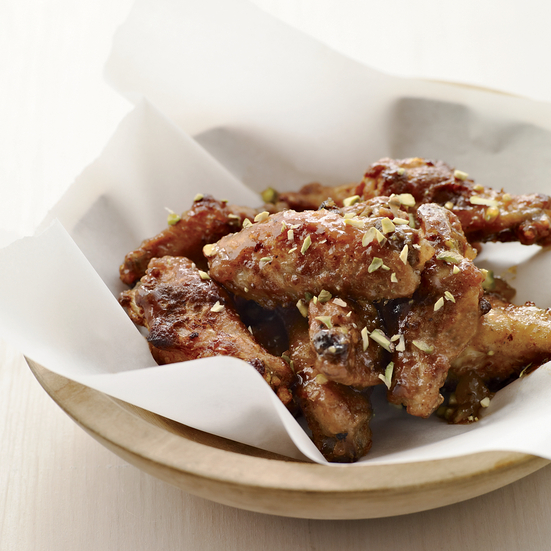 Pistachios add crunch to mango-curry wings.