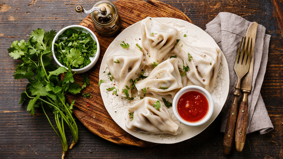 dumplings with meat and tomato sauce